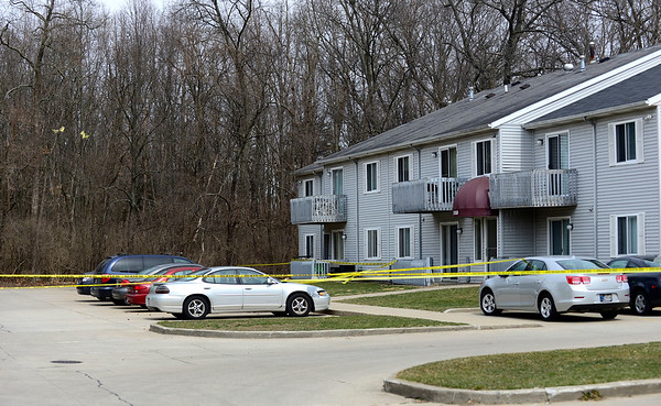 BEN MIKESELL | THE GOSHEN NEWS Elkhart Police officers responded to a report of a shooting Monday at at an apartment building, 1810 Visscher Drive, at the Walnut Trails Apartments complex in Elkhart. The investigation led to the discovery of Johnny Mullins' body in a nearby wooded area. Mullins died from a gunshot wound, and a suspect in the homicide, Cindy Goodwin, was arrested Wednesday.