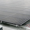 BEN MIKESELL | THE GOSHEN NEWS<br /> Goshen College is installing solar panels like these on the roof of the Rec-Fitness Center on campus to reduce electricity costs.