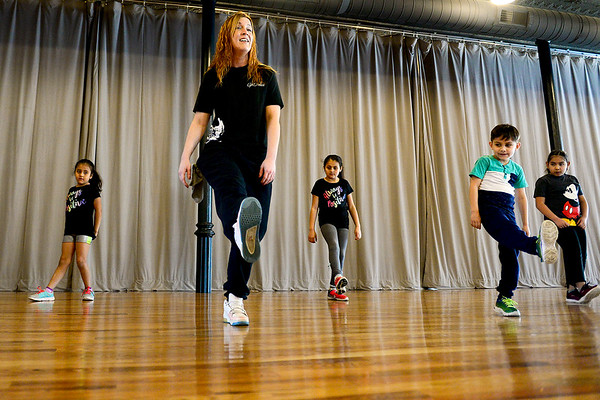 BEN MIKESELL | THE GOSHEN NEWS<br /> Dance instructor KT Solfronk, center, teaches children how to leg kick while they learn to shuffle during the first Kids Hip Hop lesson Wednesday at GoDance Studio in Goshen.