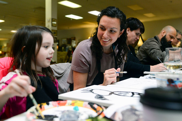 BEN MIKESELL | THE GOSHEN NEWS<br /> Sarah Archer and her daughter Hayley, 5, of Goshen paint together Thursday during Pet Portrait Day at Home Again Consignment. Hayley painted a picture of her cat, Tiger Lily, that her family adopted before Christmas last year.