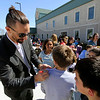 GEOFF LESAR | THE GOSHEN NEWS<br /> <br /> Goshen Mayor Jeremy Stutsman signs the shirt of James Collins, a Boys & Girls Club of Goshen member, Friday afternoon at the club. During an earlier address to the children that included representatives from CAPS and Bashor Home, Stutsman declared April Child Abuse Prevention Month in the city of Goshen.