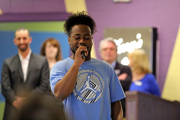 GEOFF LESAR | THE GOSHEN NEWS<br /> <br /> Jacquez Sheppard rhymes for the children of the Boys & Girls Club of Goshen Friday afternoon. Sheppard's performance followed an address by Goshen Mayor Jeremy Stutsman during which he proclaimed April Child Abuse Prevention Month for the city of Goshen.