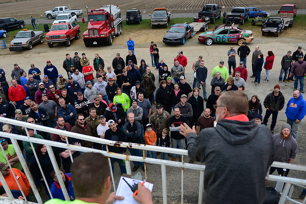 BEN MIKESELL | THE GOSHEN NEWS<br /> Randy Niles briefs drivers before Saturday's Night of Demolition parade at New Paris Speedway.