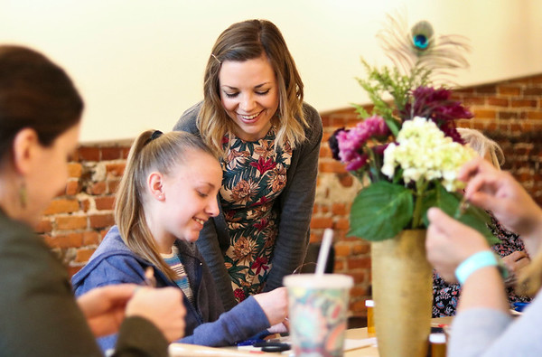 LEANDRA BEABOUT | THE GOSHEN NEWS<br /> On Saturday, Leah Householder of Goshen, center, learned to create wire jewelry from Kayci Detwiler, manager of The Beaded Peacock. This was the first workshop The Beaded Peacock, based in Winona Lake, held at Blank Space in Goshen.