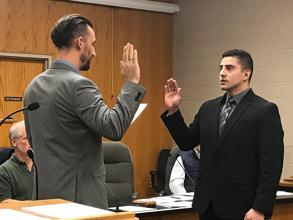 JOHN KLINE | THE GOSHEN NEWS<br /> Goshen Mayor Jeremy Stutsman, left, swears in Kevin L. Corona as a new probationary patrol officer with the Goshen Police Department during Monday's Board of Public Works and Safety meeting.