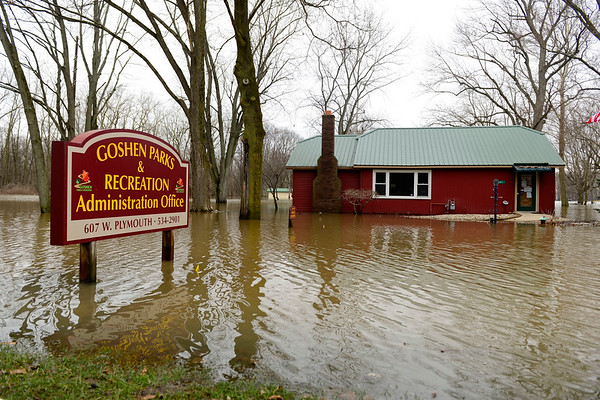 BEN MIKESELL | THE GOSHEN NEWS<br /> The Goshen Parks and Recreation Department on Plymouth Avenue is surrounded by flood water Feb. 22. The main lobby of the department took on four inches of water during the flood.