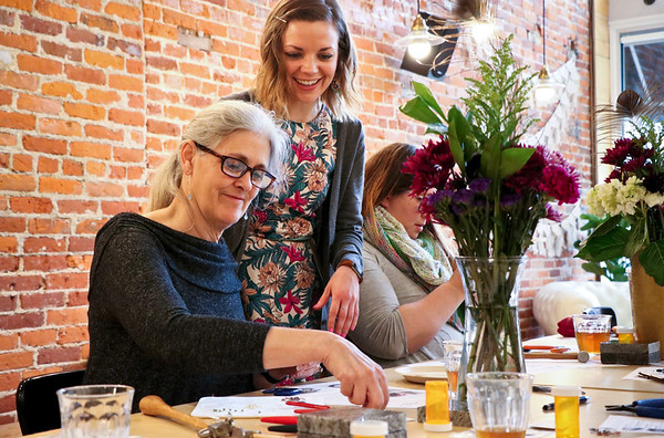 LEANDRA BEABOUT | THE GOSHEN NEWS<br /> Molly Bopp of White House, Ohio, learned how to make wire jewelry from Kayci Detwiler, manager at The Beaded Peacock in Winona Lake. The Saturday workshop was hosted by Blank Space in Goshen.
