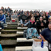BEN MIKESELL | THE GOSHEN NEWS<br /> Fans at New Paris Speedway cheer during the Super Bowl Shuffle event, part of the Night of Demolition Saturday night. In the new event this year, two drivers on each team used their cars to push an unmanned car, painted like a football, to the endzones on either end of the track.