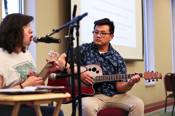 LEANDRA BEABOUT | THE GOSHEN NEWS<br /> Cin Thang, center, accompanies singer Bianca Chagoya at Fiesta Feast, a fundraiser for the Center for Healing & Hope.