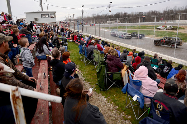 BEN MIKESELL   THE GOSHEN NEWS<br /> Fans at New Paris Speedway watch during the Super Bowl Shuffle event, part of the Night of Demolition Saturday night. In the new event this year, two drivers on each team used their cars to push an unmanned car, painted like a football, to the endzones on either end of the track.