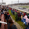 BEN MIKESELL | THE GOSHEN NEWS<br /> Fans at New Paris Speedway watch during the Super Bowl Shuffle event, part of the Night of Demolition Saturday night. In the new event this year, two drivers on each team used their cars to push an unmanned car, painted like a football, to the endzones on either end of the track.