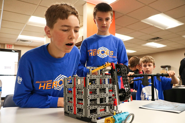 LEANDRA BEABOUT   THE GOSHEN NEWS<br /> Jonathan Wesco, 13, of Granger and Mark Renner, 11, of Wakarusa set up their team's Lego robot at Indiana Tech's first Technology Day.