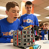 LEANDRA BEABOUT | THE GOSHEN NEWS<br /> Jonathan Wesco, 13, of Granger and Mark Renner, 11, of Wakarusa set up their team's Lego robot at Indiana Tech's first Technology Day.
