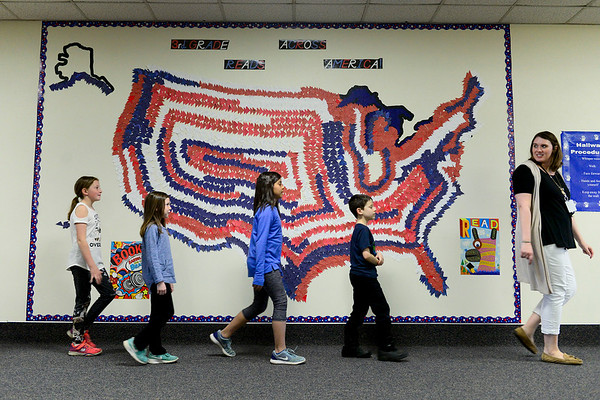 BEN MIKESELL | THE GOSHEN NEWS<br /> Students in Kara Short's third-grade class walk down the hallway past the Read Across America mural Thursday at Shipshewana Scott Elementary School. About 65 students in third grade have read over 7,200 books this school year, Principal Ian Zuercher said.