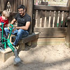 SHEILA SELMAN | THE GOSHEN NEWS<br /> Noah Stanley, 3, Goshen, scoops sand while his uncle, Shawn Wilson, watches Monday afternoon at Tommy's Kids Castle at Shanklin Park in Goshen.