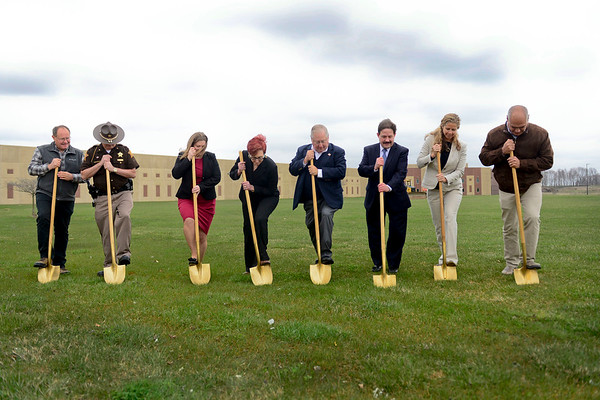 BEN MIKESELL | THE GOSHEN NEWS<br /> From left, Matt Grubb, Brad Rogers, Vicki Becker, Deborah Domine, John Letherman, Mike Christofeno, Suzanne Weirick and Frank Lucchese break ground for the Elkhart County Juvenile Detention and Intake Center Tuesday at the Elkhart County Corrections Complex.