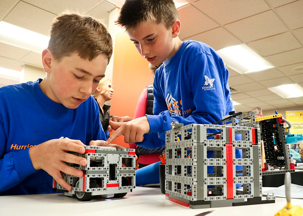 LEANDRA BEABOUT | THE GOSHEN NEWS<br /> Jonathan Wesco, 13, of Granger and Mark Renner, 11, of Wakarusa show off their Lego robot at Indiana Tech's first Technology Day.