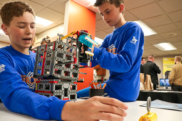 LEANDRA BEABOUT | THE GOSHEN NEWS<br /> Jonathan Wesco, 13, of Granger and Mark Renner, 11, of Wakarusa demonstrate the capabilities of their Lego robot at Indiana Tech's first Technology Day.
