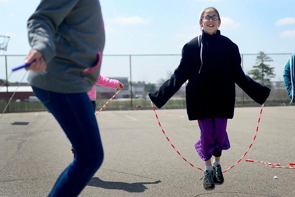 BEN MIKESELL | THE GOSHEN NEWS<br /> Fourth-grade student Lynette Miller jumps rope during recess Thursday at Shipshewana Scott Elementary School.