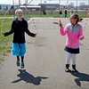 BEN MIKESELL | THE GOSHEN NEWS<br /> Fourth-grade students Serena Yoder, left, and Hannah Miller, right, practice their jump rope skills during recess Thursday at Shipshewana Scott Elementary School. The wellness team at Shipshewana Scott created the jump rope club this year and it has become a trend at recess.
