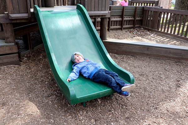 SHEILA SELMAN | THE GOSHEN NEWS<br /> After multiple slides, Rhett Byng, 3, Goshen, decides to take a momentary break on the slide at Tommy's Kids Castle at Shanklin Park in Goshen Monday afternoon.