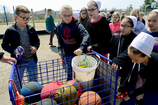BEN MIKESELL   THE GOSHEN NEWS<br /> After recess is over, fourth-grade students at Shipshewana Scott Elementary put their jump ropes back into the cart with the rest of the basketballs.