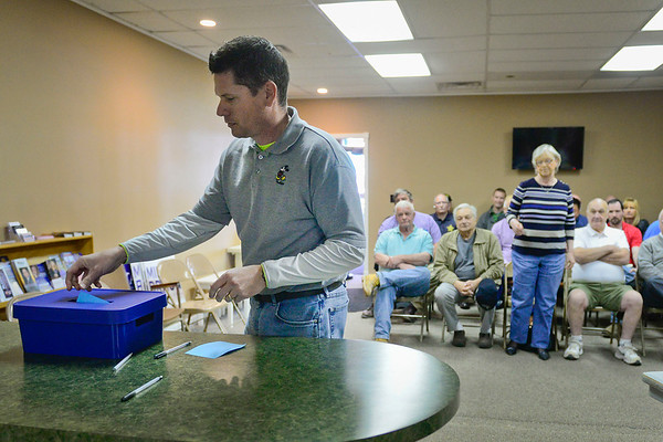 BEN MIKESELL | THE GOSHEN NEWS<br /> Ed Ahlersmeyer, a precinct committeeman and former Goshen City Council representative for District 2, casts a vote for his council replacement during a special caucus held at the Elkhart County Republican Party Headquarters in Goshen Tuesday.