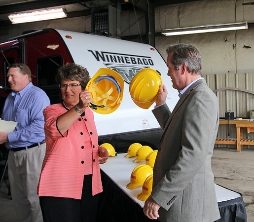 GEOFF LESAR | THE GOSHEN NEWS <br /> <br /> Rep. Jackie Walorski, 2nd District, clinks safety hats with S. Scott Degnan, vice president and general manager of Winnebago Towable Division, Thursday afternoon at the Winnebago Towable campus in Middlebury.