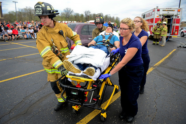 BEN MIKESELL   THE GOSHEN NEWS<br /> Firefighters from Topeka Fire Department and EMT students from Westview Jr.- Sr. High School participate in a mock crash Friday afternoon in Westview's parking lot to show the dangers of drunk driving. Juniors and seniors preparing for their Prom dance this weekend were invited out to watch first responders pull actors from the wreckage. The EMT students are seniors at Westview, and have been training at Parkview Hospital in LaGrange.