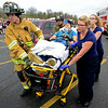 BEN MIKESELL | THE GOSHEN NEWS<br /> Firefighters from Topeka Fire Department and EMT students from Westview Jr.- Sr. High School participate in a mock crash Friday afternoon in Westview's parking lot to show the dangers of drunk driving. Juniors and seniors preparing for their Prom dance this weekend were invited out to watch first responders pull actors from the wreckage. The EMT students are seniors at Westview, and have been training at Parkview Hospital in LaGrange.
