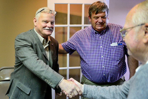 BEN MIKESELL | THE GOSHEN NEWS<br /> Doug Nisley, left, is congratulated by Sen. Blake Doriot, center, and Precinct Committeeman Bob Moore after being selected to fill former Goshen City Councilman Ed Ahlersmeyer's District 2 seat during a special caucus Tuesday at the Elkhart County Republican Party Headquarters.