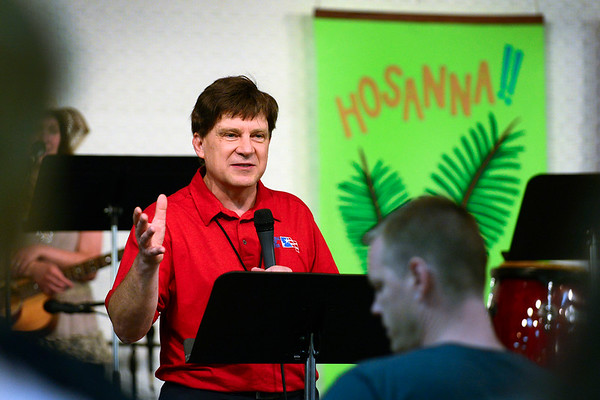 BEN MIKESELL | THE GOSHEN NEWS<br /> Tim Henke leads the National Day of Prayer noon service Thursday at Life Spring Community Church in Goshen.
