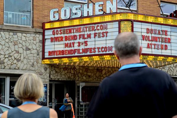 BEN MIKESELL   THE GOSHEN NEWS<br /> Movie-goers walk across Main Street toward Goshen Theater during the first day of the 2018 River Bend Film Festival Thursday in Goshen.