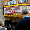 BEN MIKESELL | THE GOSHEN NEWS<br /> Movie-goers walk across Main Street toward Goshen Theater during the first day of the 2018 River Bend Film Festival Thursday in Goshen.