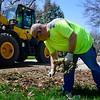 BEN MIKESELL | THE GOSHEN NEWS<br /> Mike Hrynewycz with the Goshen Street Department picks up leftover twigs while cleaning up brush Monday afternoon on Carter Road in Goshen. Monday was the first day for brush and leaf pickup this Spring. Crews will be passing through the city until collection is completed Friday, May 11.