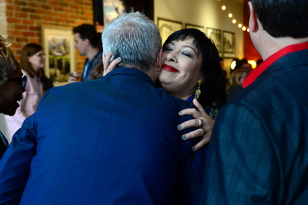 BEN MIKESELL | THE GOSHEN NEWS<br /> Carrie Lee Bland Kendall, Goshen, gives a hug during the opening reception for the 2018 River Bend Film Festival Thursday at Gateway Cellar Winery in Goshen.