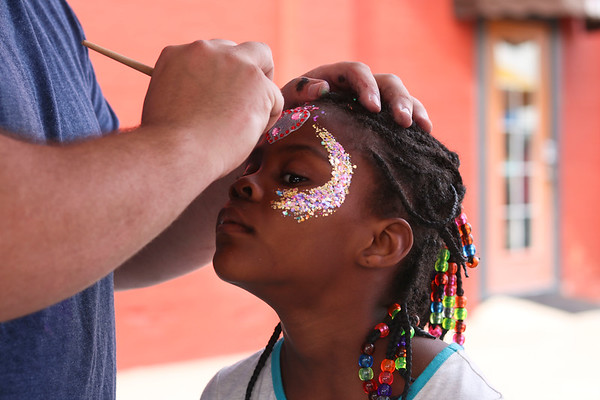 LEANDRA BEABOUT | THE GOSHEN NEWS<br /> Zharia Gunn, 6, gets her face painted at Goshen's First Friday