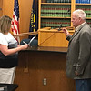 JOHN KLINE | THE GOSHEN NEWS<br /> Angie McKee, clerk-treasurer for the city, left, swears in Doug Nisley as the newest member of the Goshen City Council during the council's meeting Tuesday evening. Nisley was chosen in a special caucus Tuesday morning to fill the District 2 seat recently vacated by fellow Republican and former Goshen City Councilman Ed Ahlersmeyer.