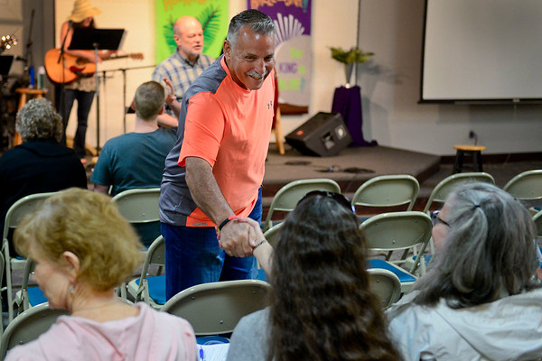 BEN MIKESELL | THE GOSHEN NEWS<br /> Larry Sheets, Syracuse, greets people prior to the National Day of Prayer noon service Thursday at Life Spring Community Church in Goshen.