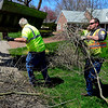 BEN MIKESELL | THE GOSHEN NEWS<br /> Matt Beard, right, with the Goshen Street Department carries branches while cleaning up brush Monday afternoon on Carter Road in Goshen. Monday was the first day for brush and leaf pickup this Spring. Crews will be passing through the city until collection is completed Friday, May 11.