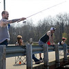 BEN MIKESELL | THE GOSHEN NEWS<br /> Goshen resident Brady Mollette casts a line into the Goshen Mill Race Tuesday while enjoying the warm, 80 degree weather.