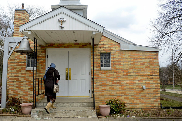 BEN MIKESELL   THE GOSHEN NEWS<br /> Church-goers attend the Good Friday service at Holy Virgin Protection Orthodox Church in Goshen.