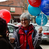 BEN MIKESELL | THE GOSHEN NEWS<br /> Bristol resident Sandy Imanse hands out balloons to people along Main Street in Goshen during April's First Friday event.