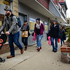 BEN MIKESELL | THE GOSHEN NEWS<br /> People bundle up to walk down Main Street in Goshen for April's First Friday.