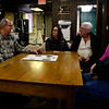 BEN MIKESELL | THE GOSHEN NEWS<br /> Dale Garber, curator for the Goshen Historical Society Museum, talks to people gathered for a roundtable discussion on Goshen's history during April's First Friday event.