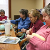 LEANDRA BEABOUT | THE GOSHEN NEWS<br /> Linda Corwin, left, drives from her Wakarusa home to Greencroft Goshen every Monday to participate in the knitting group. To her right is Helen Detwiler.