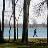"""BEN MIKESELL   THE GOSHEN NEWS<br /> Felicia Miller of New Paris takes a stroll down the path at Fidler Pond Park Wednesday afternoon in Goshen. """"I love coming out here,"""" Miller said, enjoying the Spring weather. Temperatures are expected to rise throughout the rest to upper 60 degrees by Friday, but could fall to near 40 degrees again by next Monday, Kyle Brown with the National Weather Service said."""