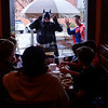 BEN MIKESELL | THE GOSHEN NEWS<br /> Batman and Superman, played by Elkhart residents Matthew Long and Jonathan Suddart respectively, surprise kids inside Jojo's Pretzels during April's First Friday.