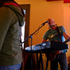 BEN MIKESELL | THE GOSHEN NEWS<br /> Local musician Don Savoie plays his music inside Jojo's Pretzels in Goshen for April's First Friday.