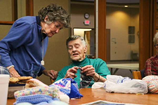 LEANDRA BEABOUT   THE GOSHEN NEWS<br /> Laverne Nafziger, right, helps Gretta Peterson with a difficult stitch during Greencroft Goshen's Monday afternoon knitting group. The informal group meets at the Community Center from 1-3 p.m. weekly and is free of charge.